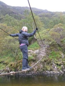 Elaina crossing Steall wire bridge
